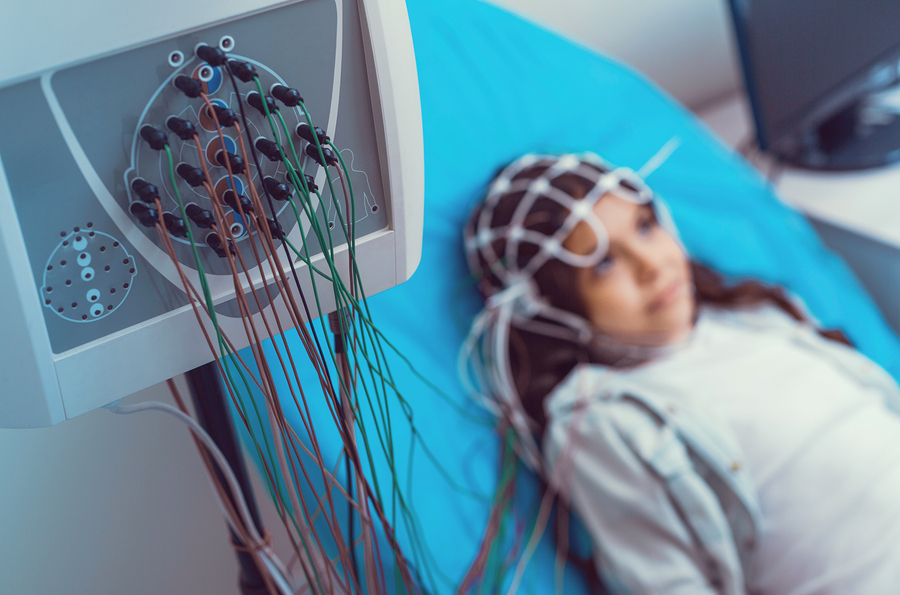 Poor little girl getting her brain analyzed at laboratory